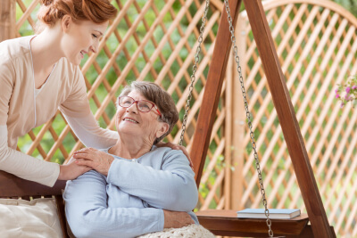 senior woman accompany by her caregiver